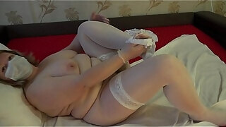 mature plump nurse treats sexual arousal therapy on the example of a rubber dick and cream pie