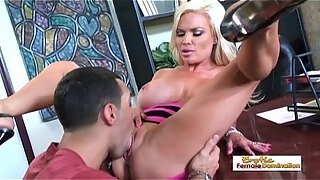 busty blonde bombshell gets fucked on top of an office desk