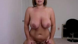 busty blonde milf fucks a dildo on a webcam show