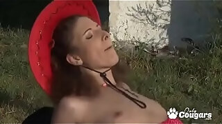 cowgirl norah swan slides her thong to the side and sticks a little pecker in her butt